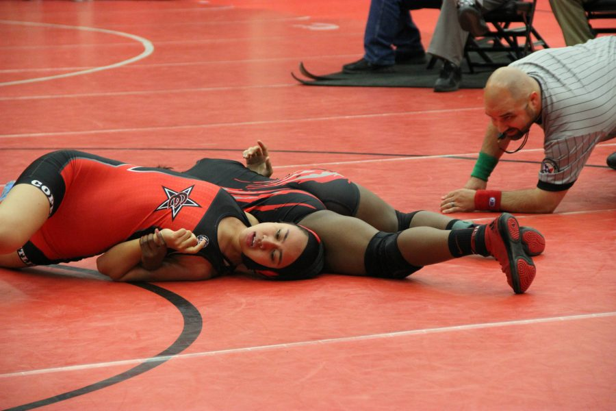 Coppell+High+School+senior+Alianna+Laione+gets+pinned+down+by+opponent+from+Liberty+High+School+last+Friday+in+the+Coppell+Arena.+With+a+solid+performance%2C+the+Coppell+Cowboys+girl%27s+wrestling+team+places+top+three+in+multiple+weight+categories.