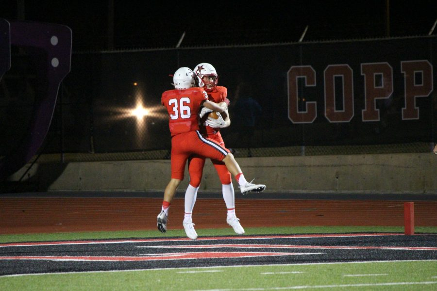 Senior defensive backs Skyler Seidman and Ben Goyne celebrate after Goyne's pick-six in one of Coppell's early-season home district victories. Seidman, Goyne and the other defensive seniors will be missed by the Coppell defense in the following year.
