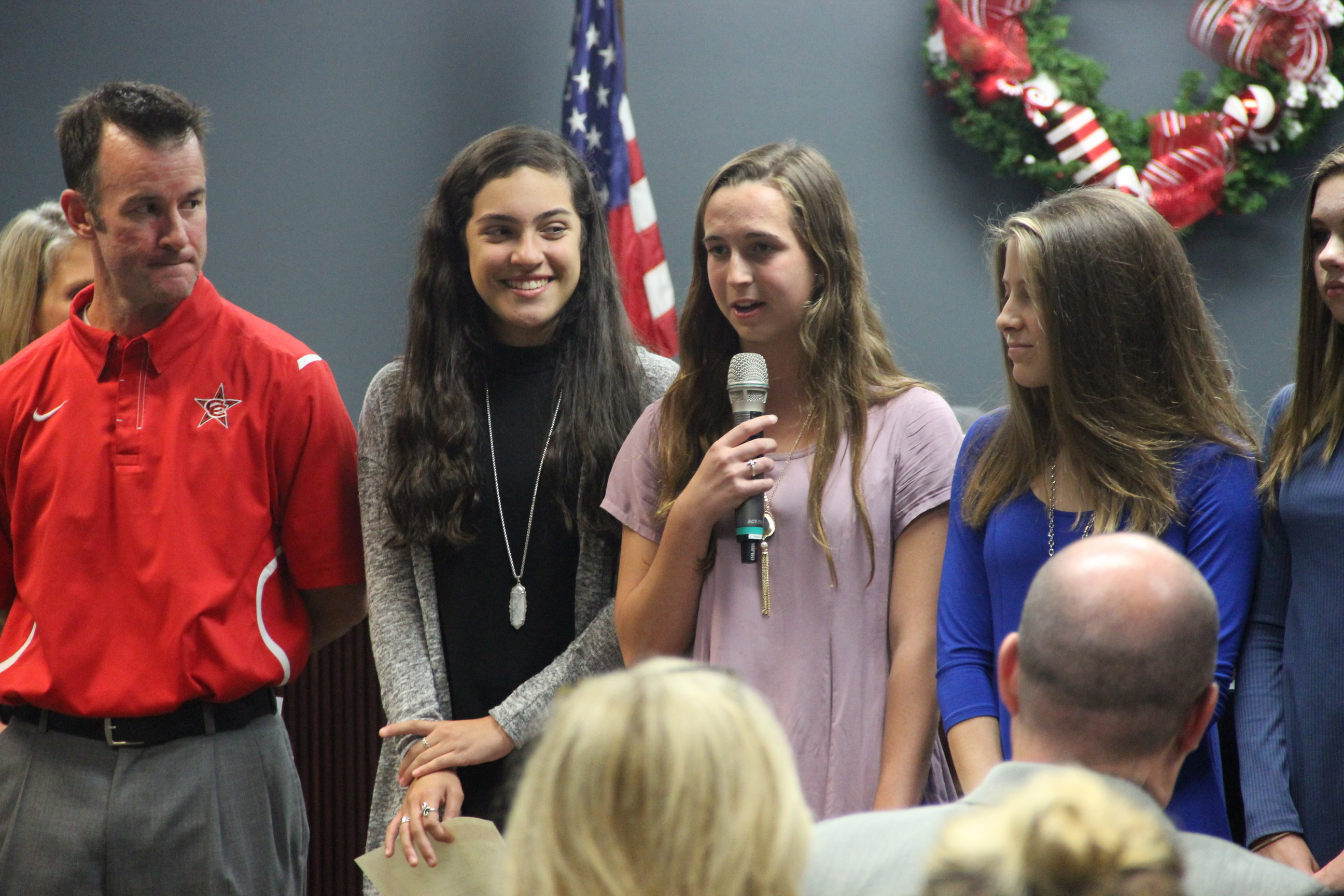 Coppell High School senior Miranda Dickson is recognized alongside the CHS girls cross country team at a Board meeting on Monday. Dickson shared her intent to attend the University of Texas for Business. Photo by Amanda Hair.