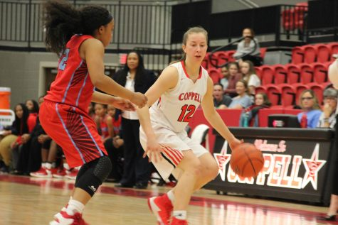 Senior guard Emma Johnson looks for a passing lane in Coppell's double overtime 66-60 loss to Skyline on Tuesday. Johnson and the Cowgirls fought hard, but were unable to hold onto a large lead created in the third quarter.