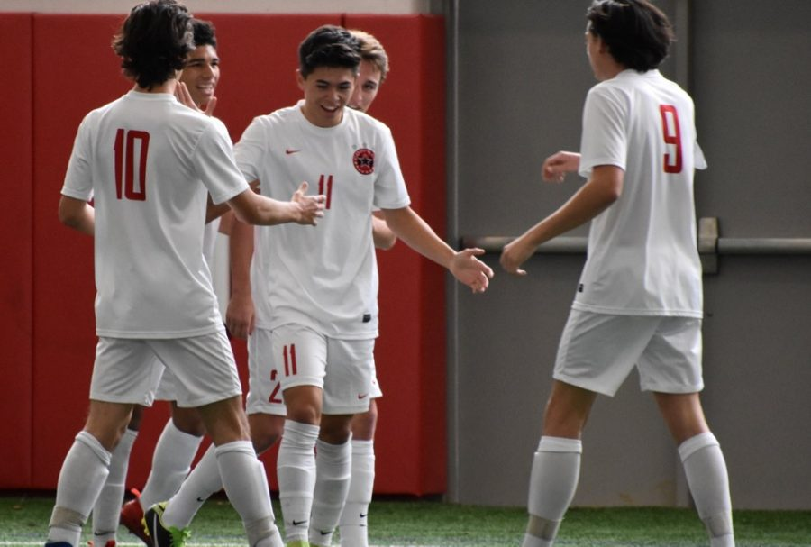 Coppell+junior+forward+Wyatt+Priest+%2810%29%2C+senior+forward+Nick+Taylor+%2811%29+and+senior+midfielder+Alex+Haas+%289%29+celebrate+Taylor%27s+goal+during+the+first+half+of+Saturday%27s+game+in+the+Coppell+indoor+facility.++The+Cowboys+defeated+El+Paso+Socorro+4-1+to+win+the+North+Texas+Elite+Showcase+Tournament.