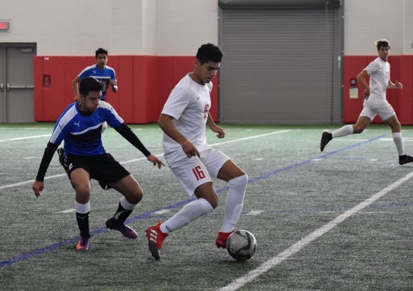 Coppell+junior+forward+Francisco+Redondo+dribbles+around+El+Paso+Socorro%27s+defense+during+the+first+half+of+Saturday+afternoon%27s+game+in+the+Coppell+indoor+facility.+The+Cowboys+defeated+El+Paso+Socorro+4-1+to+win+the+North+Texas+Elite+Showcase+Tournament.%0A