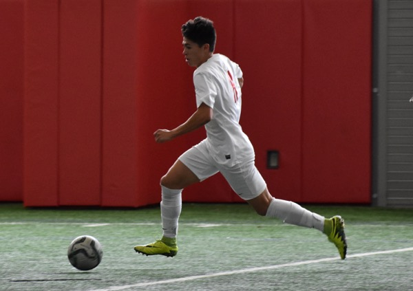Coppell+senior+forward+Nick+Taylor+dribbles+downfield+to+later+score+his+second+goal+of+the+game+on+Saturday+against+El+Paso+Socorro+in+the+Coppell+indoor+facility.+The+Cowboys+defeated+El+Paso+Socorro+4-1+to+win+the+North+Texas+Elite+Showcase+Tournament.%0A%0A