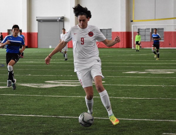 Coppell+senior+midfielder+Alex+Haas+dribbles+downfield+during+Saturday%27s+game+against+El+Paso+Socorro+in+the+Coppell+indoor+facility.+The+Cowboys+defeated+El+Paso+Socorro+4-1+to+win+the+North+Texas+Elite+Showcase+Tournament.%0A