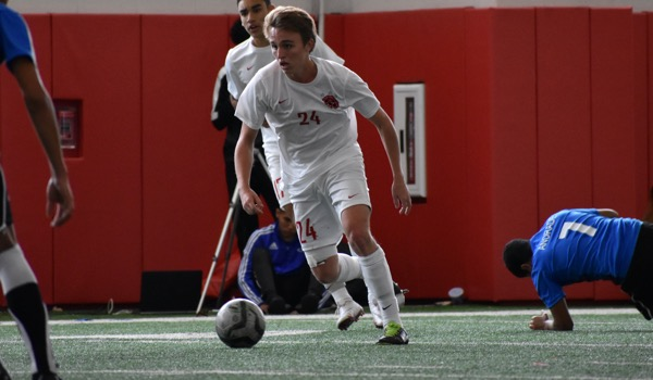Coppell+senior+midfielder+Parker+McClure+looks+to+cross+during+the+first+half+of+Saturday%27s+game+in+the+Coppell+indoor+facility.++The+Cowboys+defeated+El+Paso+Socorro+4-1+to+win+the+North+Texas+Elite+Showcase+Tournament.%0A