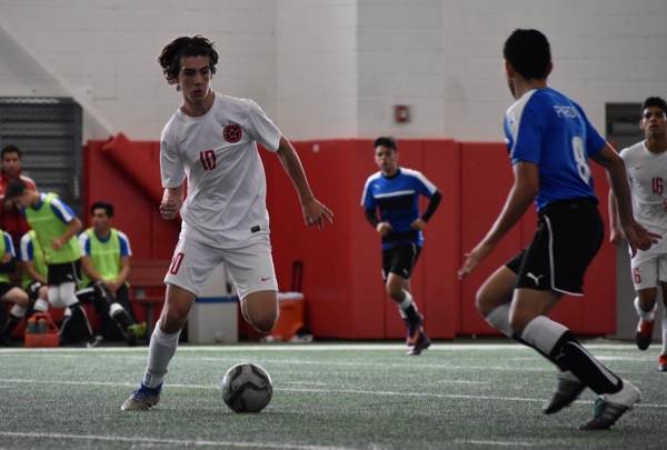 Coppell+junior+forward+Wyatt+Priest+dribbles+around+El+Paso+Socorro%27s+defense+during+the+first+half+of+Saturday+afternoon%27s+game+in+the+Coppell+indoor+facility.+The+Cowboys+defeated+El+Paso+Socorro+4-1+to+win+the+North+Texas+Elite+Showcase+Tournament.%0A%0A