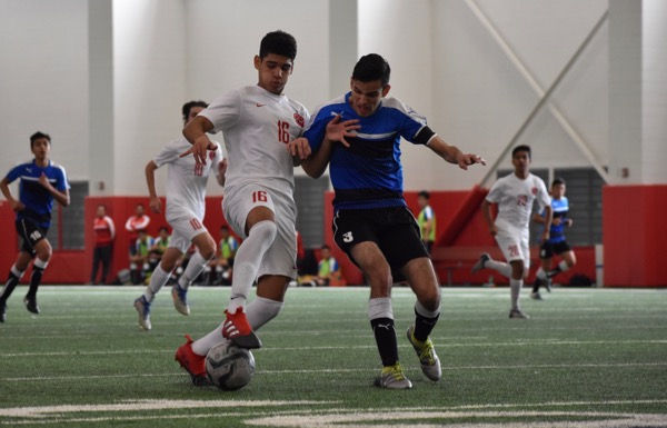 Coppell+junior+forward+Francisco+Redondo+dribbles+downfield+during+Saturday%27s+game+against+El+Paso+Socorro+in+the+Coppell+indoor+facility.+The+Cowboys+defeated+El+Paso+Socorro+4-1+to+win+the+North+Texas+Elite+Showcase+Tournament.%0A
