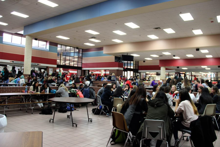 Coppell High School students with English or Fine Arts as their third period classes attended A lunch, the first lunch out of four with the block schedule, today in the cafeteria. With four lunches as opposed to the usual three, there were less students in each lunch period and the lunch lines were more efficient. Photo by Hannah Tucker.