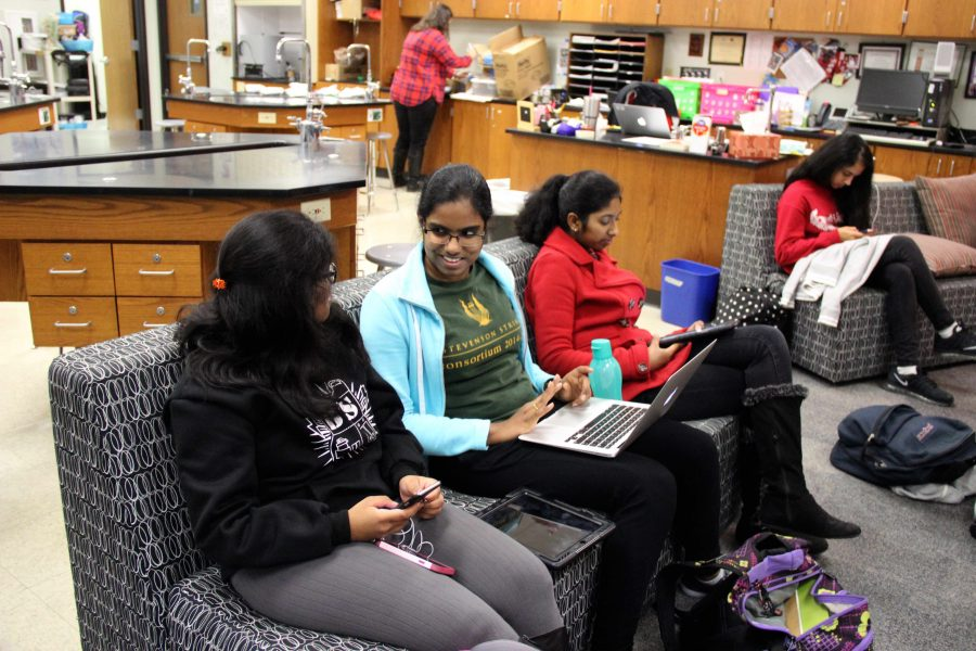 Coppell High School sophomores Alarika Voora, Mahima Vermuri and Rithika Vijayaragavan gather in Chemistry teacher Chris Stricker's classroom for their added eighth period this afternoon on the B Day of the test run of the block schedule. In this temporary eighth period, added due to the block schedule, freshmen and sophomores learned about coding and gained inspiration for future careers. Photo by Hannah Tucker.