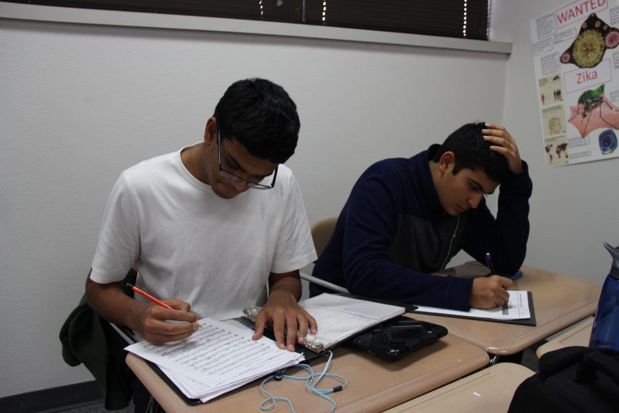 Coppell High School sophomores Akshaj Turebylu and Patrick Unnikrishnan work on homework in their designated classroom this afternoon after finishing their given eighth period activity on the B Day of the test block schedule on Thursday. In this temporary eighth period, freshmen and sophomores learned about coding and gained inspiration for future careers. Photo by Hannah Tucker.