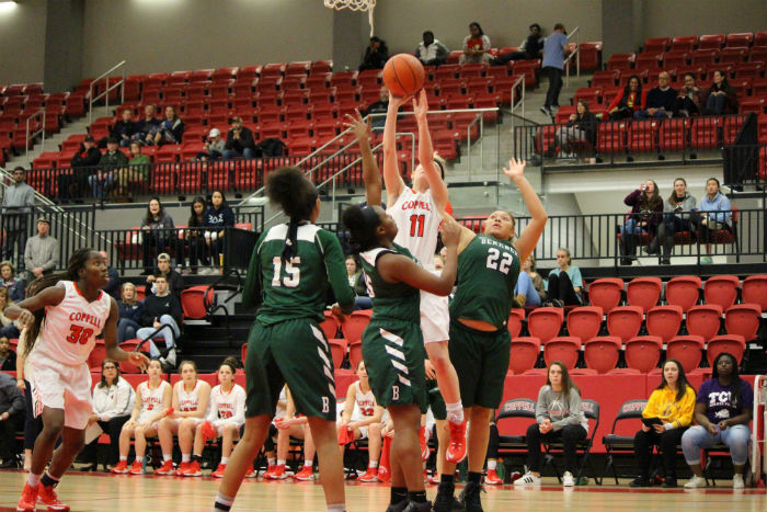 Coppell High School senior small forward Paige Haas attempts a shot while surrounded by Berkner players during Saturday afternoon's game, originally scheduled for Friday evening but moved due to snow, at the CHS arena. The Rams defeated the Cowgirls with a last minute to end the game 48-47.