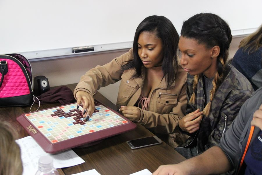 Coppell High School juniors Arlever Gipson and Jamia Mosby (left to right) play Scrabble to engage in team building during Courtney Orloff's third period class on Tuesday. At the end of every six weeks, Orloff's classes take a day to get to know each other better and enjoy a laid back day.