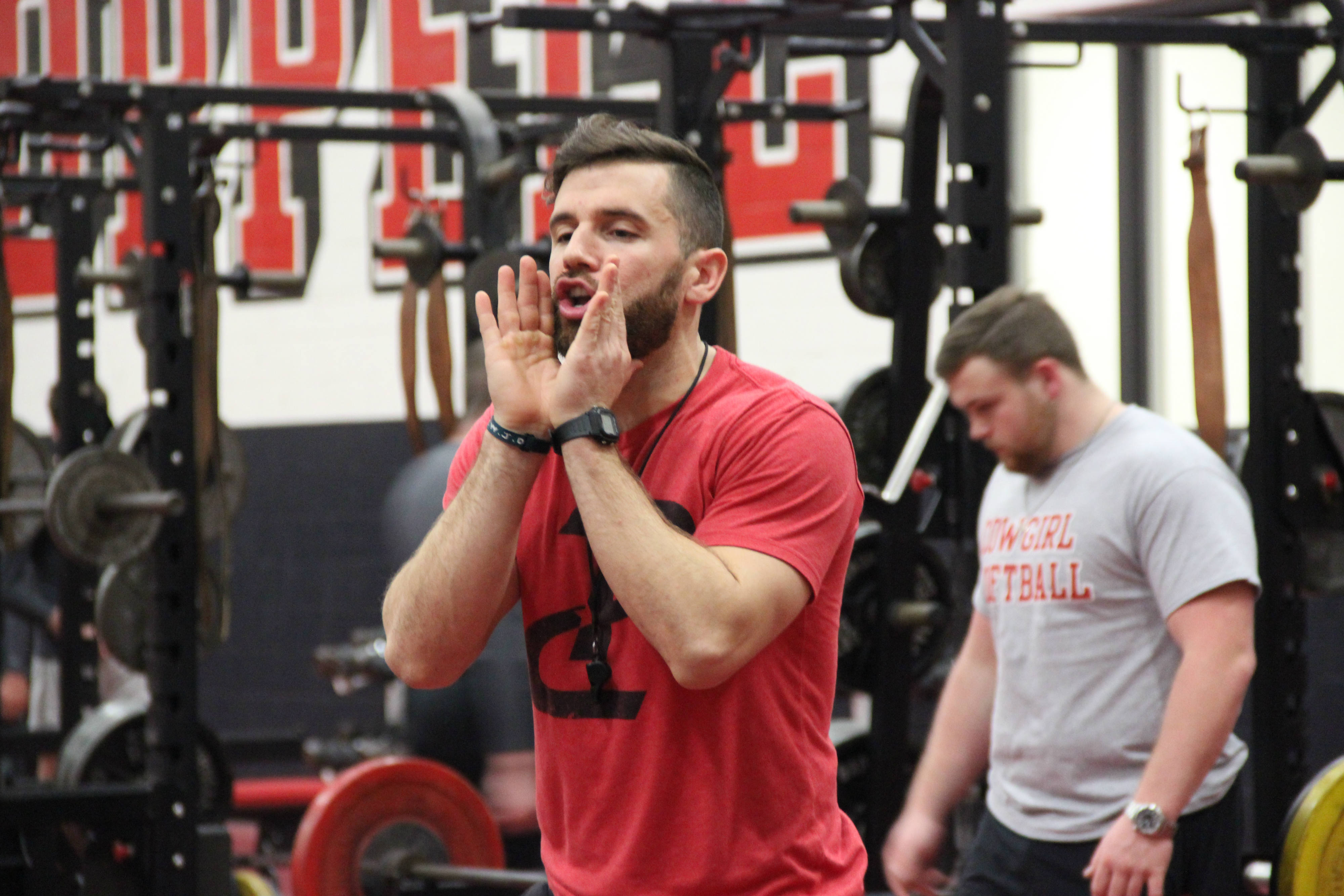Coppell Performance Course director Stephen Baca motivates the athletes to push on in their workout after school last Thursday in the Coppell High School weight room. Baca has a very motivational personality and hosts workouts before and after school with CHS athletes. Photo by Hannah Tucker.