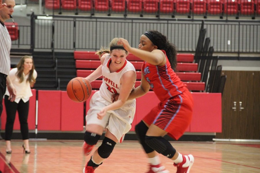 Coppell High School senior point guard Rachel Crutchfield drives the ball down the court as the the second quarter of last nights game comes to a close. After a double overtime game, the Skyline Lady Raiders claimed a 66-60 victory over the Coppell Cowgirls. Photo by Amanda Hair.