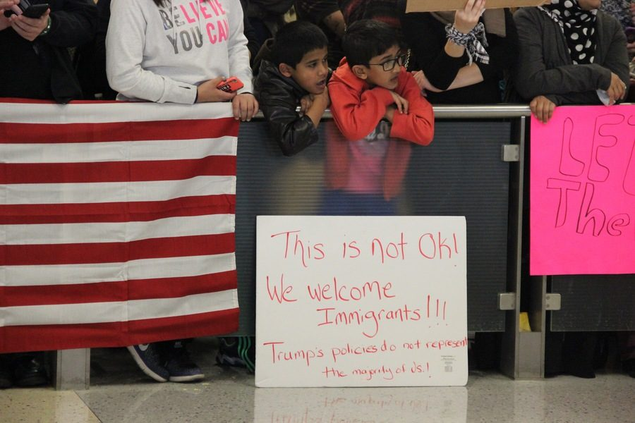 Children squeeze to the front of the crowd of protesters to watch people walking through the arrivals gate on Sunday at Dallas-Fort Worth International Airport. Often during the protest, which concerned the president's immigration ban on seven Muslim majority countries, cheers would erupt every time a traveller passed through the gate to baggage claim.