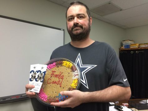 AP Calculus teacher coach Kirk Richardson shows off the Dallas Cowboys football tickets and cookie cake that his students all gifted him with Thursday morning in his classroom. As a lifelong Cowboys fan, Richardson was surprised when he walked into his classroom and saw the gift awaiting him.