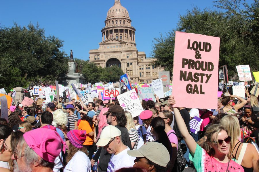 A+sign+referencing+a+remark+made+by+President+Donald+Trump+is+held+by+a+demonstrator+during+the+Women%E2%80%99s+March+on+Austin+on+Saturday+morning.+The+march+began+at+the+Capitol%2C+where+a+crowd+of+50%2C000+people+gathered+in+advocacy+of+women%E2%80%99s+rights+and+civil+rights.