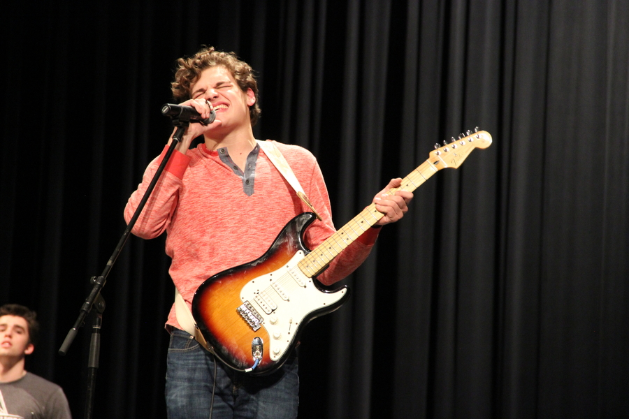Coppell High School senior Eric Loop sings with his band Auto at the CHS talent show on Friday night in the auditorium. Over 15 acts performed at the show and the audience voted on the winners.