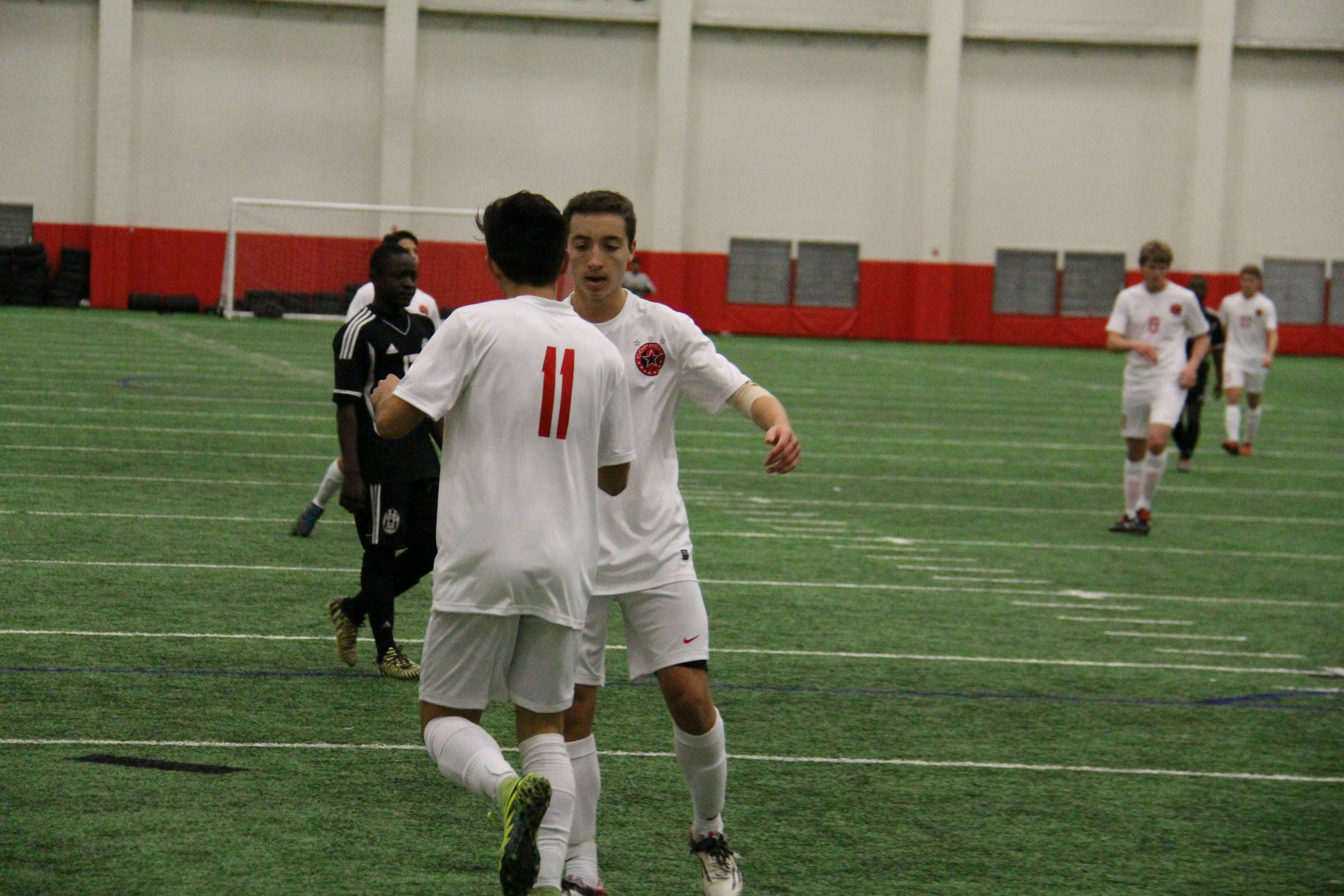 Senior forward Nick Taylor (11) and senior defender Jacob McEwen embrace after Taylor's goal in the second half of Coppell's 5-0 win over Sam Houston. Taylor recorded a goal and three assists in the Cowboys' two victories.