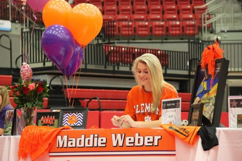Coppell High School senior Maddie Weber cheers on another signee as they sign their letter of intent a on Monday morning. Weber signed on with Clemson University to continue her soccer career. In the CHS arena, 12 CHS seniors welcomed their friends and family to join them for National Signing Day.