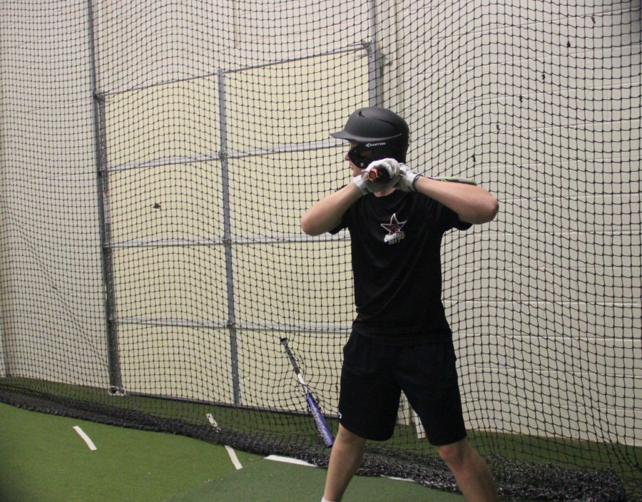 Coppell High School sophomore Nick Vernares awaits a pitch at the CHS batting cages on Feb. 21 during fourth period. Clark, an outfielder for the Cowboys, is on the varsity team for the first year.