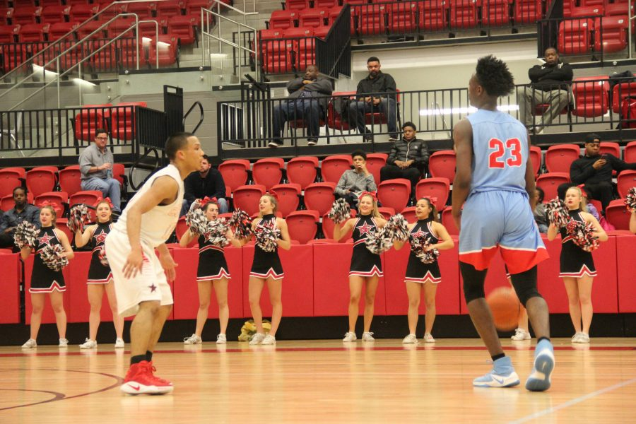 Coppell High School sophomore guard Tariq Aman tries to get past Skyline senior Raider guard Marcus Garrett Friday night in the CHS Arena at the Boys Varsity game. The Raiders went home with a 64-45 victory against the Cowboys.