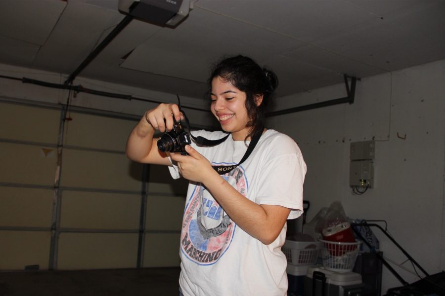 Coppell High School junior Jasmine Diaz takes a photo for her project in her garage on Tuesday night. Diaz was taking photos for her Visual Arts Scholastic Event (VASE) project entry.