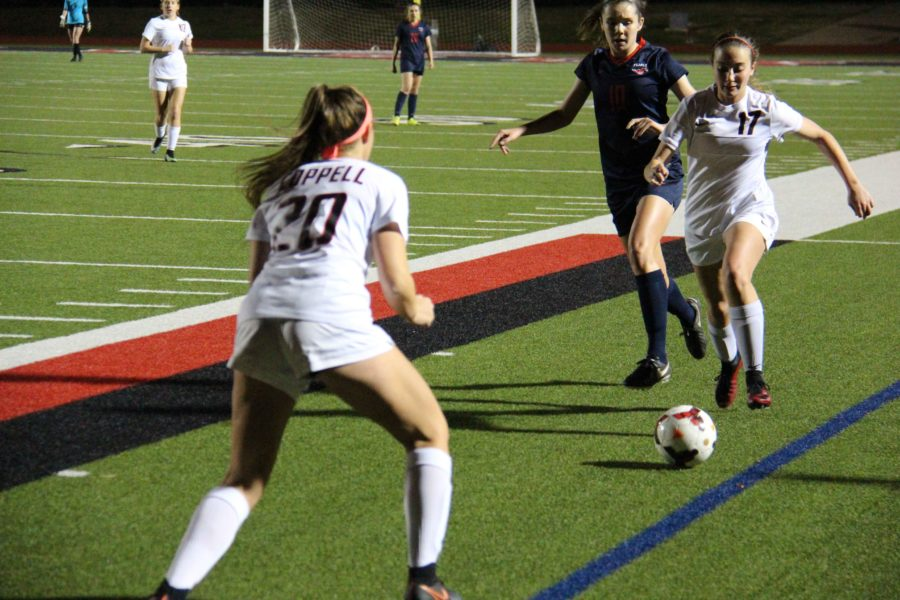 Coppell High School sophomore defender Haley Roberson dribbles up the sideline, looking to pass to sophomore forward Micayla Weathers. The Cowgirls tied Richardson Pearce,1-1, at Buddy Echols Field on Tuesday night.