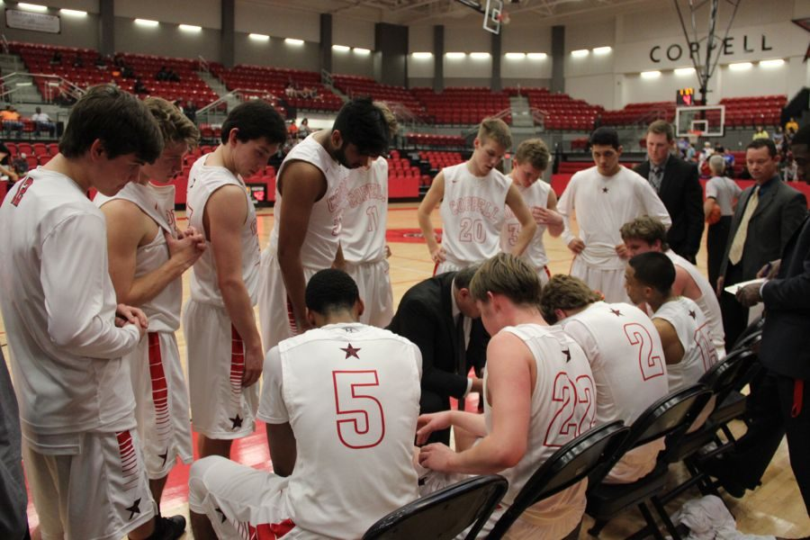 Coppell boys basketball coach Kit Pehl instructs his team after calling a timeout during the game against Berkner on Tuesday night at the CHS arena. The Cowboys came back from an 11 point halftime deficit, yet could not keep their lead, losing, 52-47.