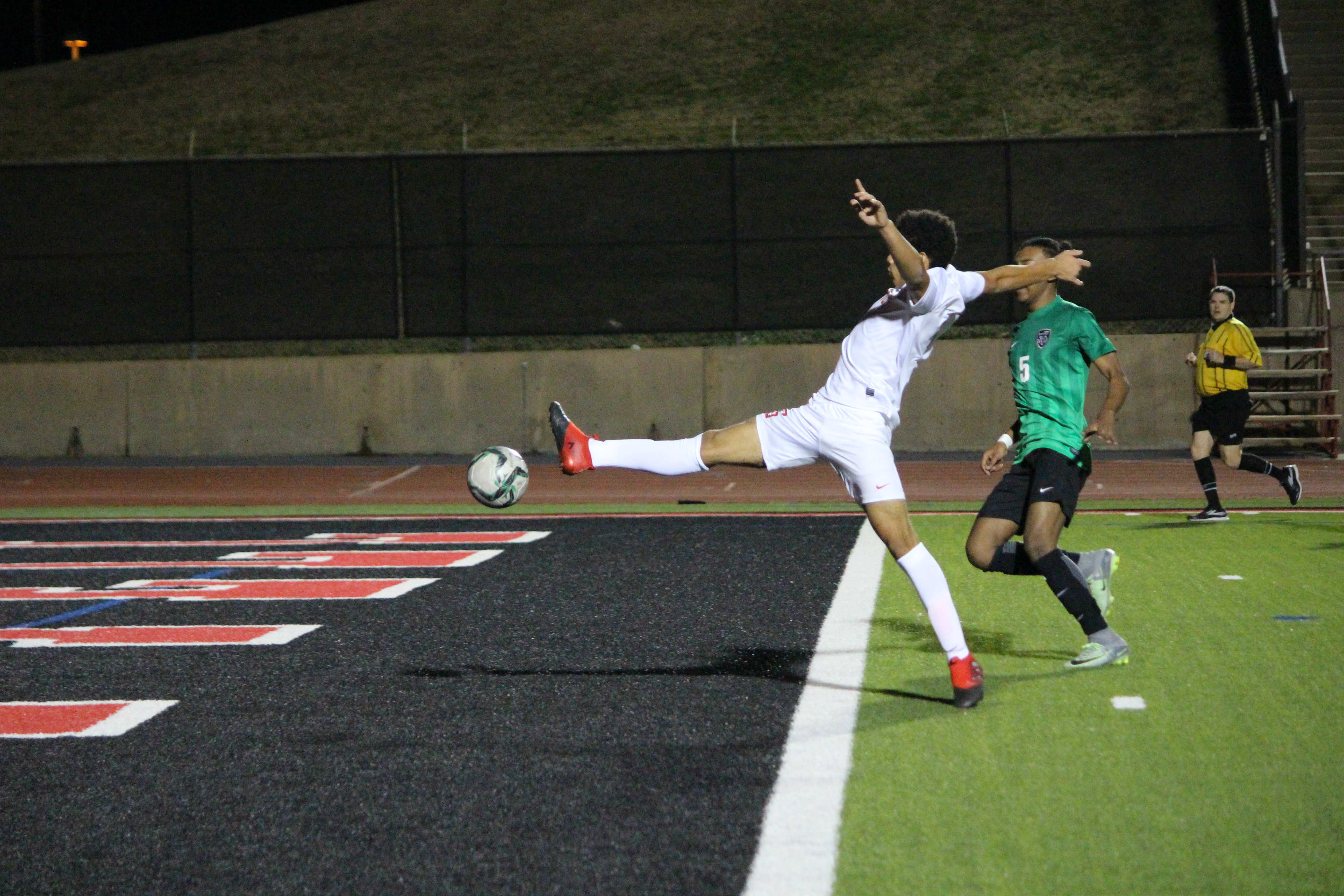 Coppell High School junior forwards Francisco Redondo tries to control a cross during the first half of Tuesday night's match at Buddy Echols Field against the Richardson Berkner High School Rams. The Cowboys defeated the Rams 4-0 with goals from senior captain and forward Nick Taylor, junior midfielder Bennett Hunter and senior captain and midfielder Bishesh Manandhar.