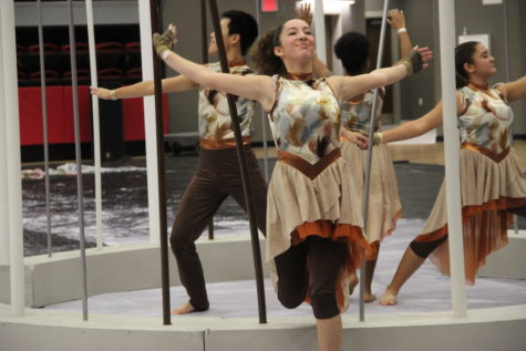 Coppell High School  Varsity winter guard member sophomore Bella Souders dances during Coppell's show at the Winter Guard International (WGI) Dallas competition on Feb. 18  in the Coppell High School arena. Their show 'Winter Bird,' and is a metaphor for being in a low point in life and persevering to a better future. Photo by Hannah Tucker.