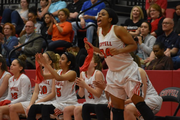 Coppell High School senior Chidera Nwaiwu cheers on the Cowgirls on Friday night in the arena. The Cowgirls fell short to the Richardson Lady Eagles 55-52.