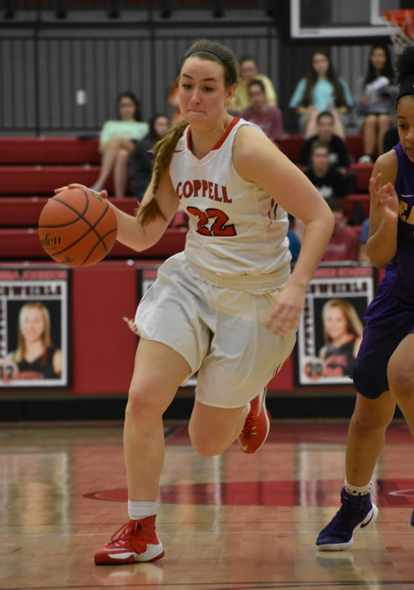 Coppell+High+School+senior+Abby+Meyer+dribbles+the+ball+down+the+court+to+later+score+on+Friday+night+in+the+CHS+arena.+The+Cowgirls+fell+short+to+the+Lady+Eagles%2C+Richardson+claiming+a+55-52+victory+over+Coppell.+%0A