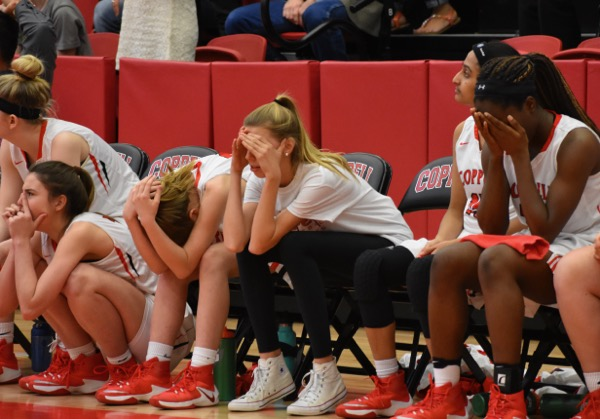 Coppell High School girls basketball players react to Richardson's game-winning free throw last night in the arena. The Cowgirls fell short with 14 seconds left in the game to lose 55-52 against the Lady Eagles.
