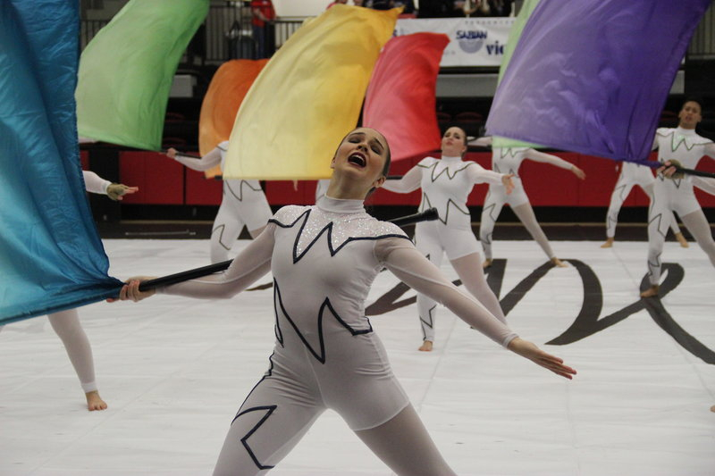 A+Black+Gold+member+shows+the+expression+of+sadness+and+pain+while+spinning+her+flag+on+Saturday+in+the+Coppell+High+School+arena+at+the+Winter+Guard+International+%28WGI%29+Dallas+competition%2C+which+is+a+circuit+for+color+guard+members+to+to+perform+their+winter+shows+for+competition+purposes.+Black+Gold%2C+an+Independent+guard%2C+meaning+they+are+all+high+school+graduates%2C+is+one+of+these+programs+who+performed+their+show+%E2%80%98One%2C%E2%80%99+which+is+a+tribute+to+the+shooting+at+Pulse+nightclub+in+Florida+and+shows+how+people+have+come+together+to+raise+awareness+and+advocate+for+their+civil+rights.+Photo+by+Hannah+Tucker.
