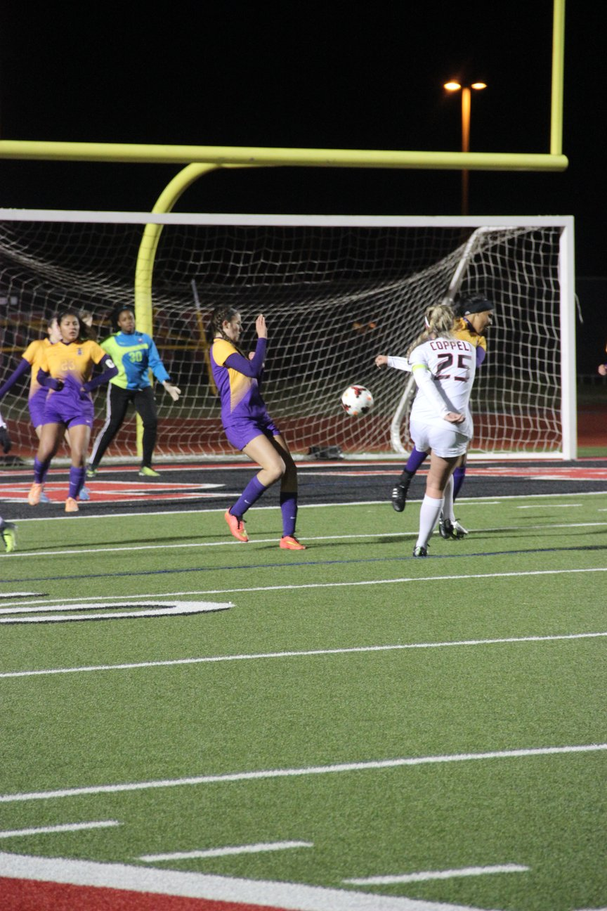 Coppell High School junior midfielder Tyler Runnels shoots the ball into the goal during Tuesday's night game against Richardson. Coppell claimed a 5-0 win over Richardson at Buddy Echols Field.