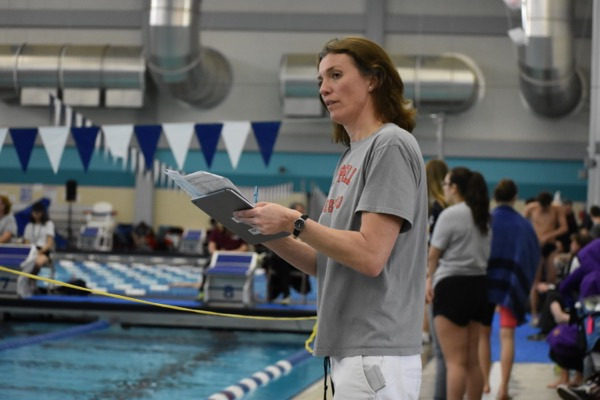 Coppell+High+School+swimming+head+coach+Marieke+Roberts+watches+her+swimmers+compete+on+Saturday+morning+at+the+LISD+Westside+Aquatic+Center.+The+Coppell+swimming+team+placed+fourth+overall+at+the+regional+meet.
