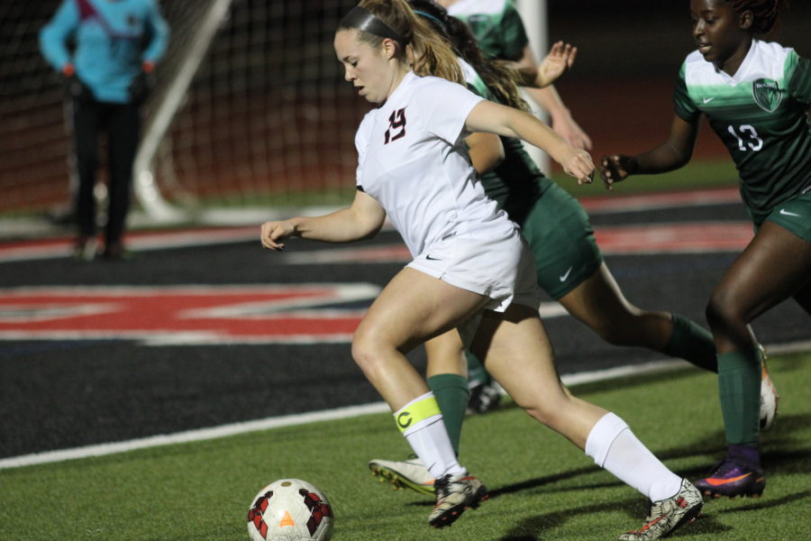 Coppell High School senior forward Baylee Hux dribbles toward the goal during the first half of Friday night's match against Berkner. The Coppell Cowgirls defeated the Berkner Rams, 7-0, at Buddy Echols Field.