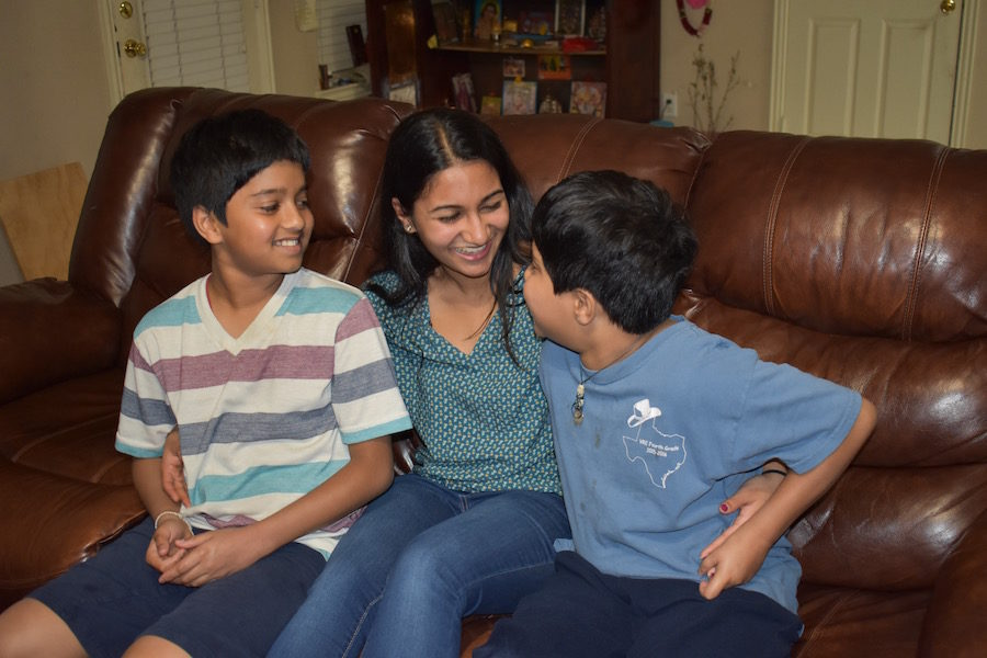 Coppell High School senior Soundarya Daliparthy's strong relationship with her twin brothers Sreeram (left) and Kartheek (right) influences her to pursue a career in speech pathology. Drawing inspiration from experiences with her autistic brother Kartheek, Daliparthy looks forward to aiding others in developing effective communication. Photo by Jessica Jun.