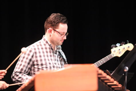 "Grammy nominated Drumset Artist Michael D'angelo plays the bass guitar at the Purely Rhythmic concert on Friday night in the CHS Auditorium. He was featured in the CHS percussion's performance of ""Cornbread Funk"" by Matt Ehlers. Photo by Hannah Tucker."