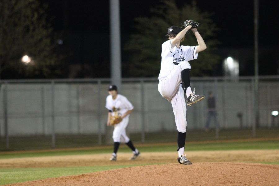 Coppell High School senior John Kodros pitches during the game against Richardson Pierce on Tuesday. Coppell won 10-0 at the end of five innings at the Coppell Baseball Complex.