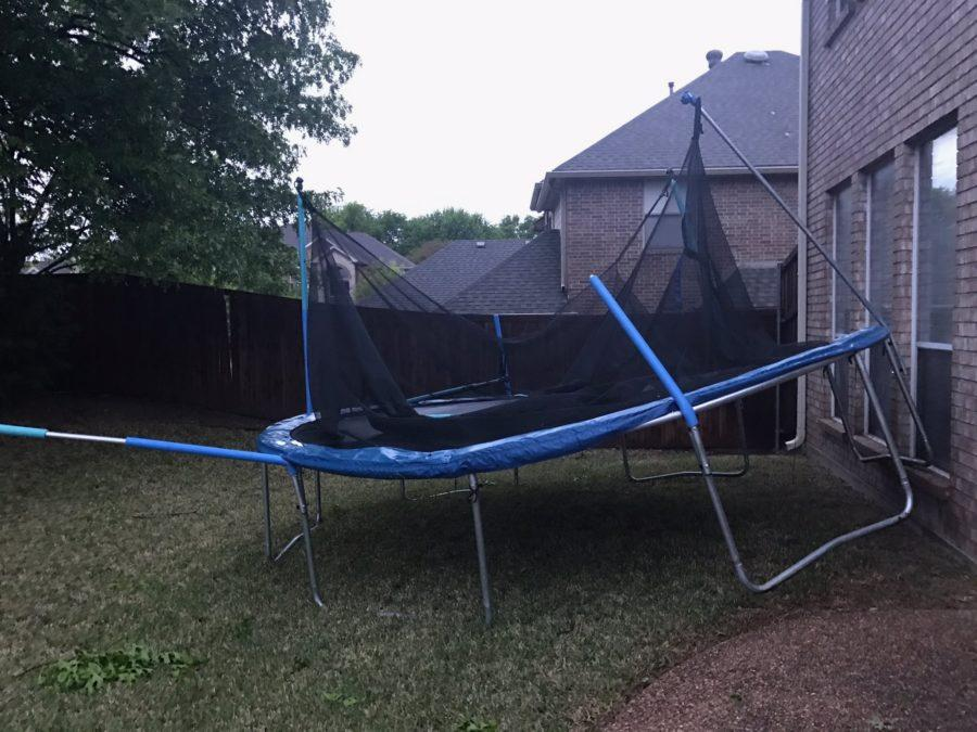 Texas Academy of Math and Science junior Esha Aggarwal captures her neighbors trampoline after it flew into her backyard due to the strong winds of last nights storm. Aggarwals Flower Mound home was one of the many that saw the effects of the high wind speeds and hail that rocked North Texas. Photo courtesy Esha Aggarwal.