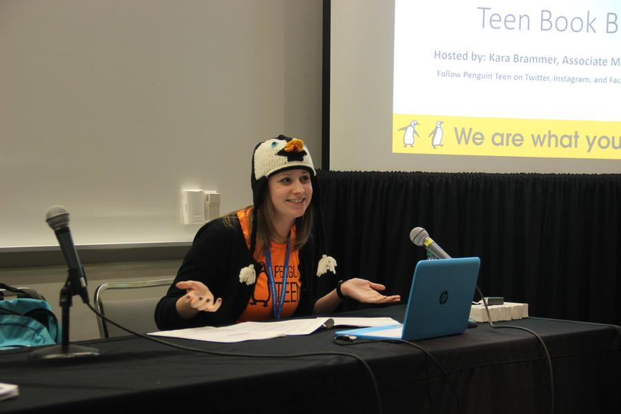 Penguin Teen's associate marketing manager Kara Brammer wears a penguin hat to talk about recent and upcoming releases during the Penguin Teen Book Buzz on Saturday at the North Texas Teen Book Festival held at the Irving Convention Center. The book buzzes were new to this year's festival, and they allowed publishers to share releases with attendees.