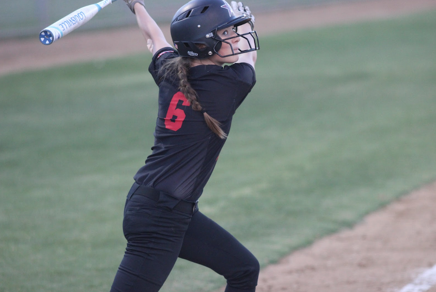Coppell High School freshman utility player Chloe Barker bats on Friday night's game at the Coppell ISD Baseball/Softball Complex. The Coppell girls softball team won, 15-0, over the Skyline Lady Raiders. Photo by Hannah Tucker.