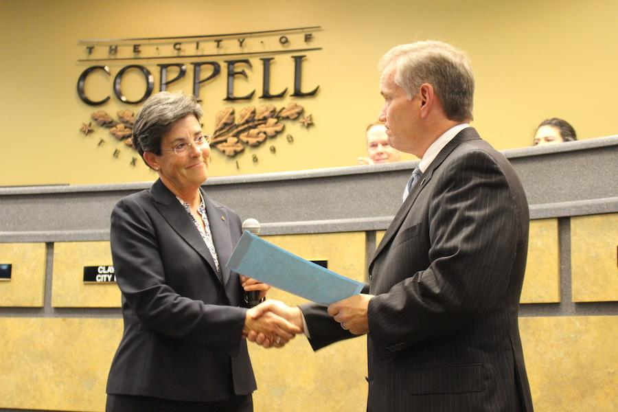 "Coppell Mayor Karen Hunt shakes City Manager Clay Phillips' hand after approving the proclamation naming March 30, 2017 as ""Clay Phillips Appreciation Day."" Phillips has been City Manager since 2008 and served in Coppell for a total of 26 years before deciding to retire this year."