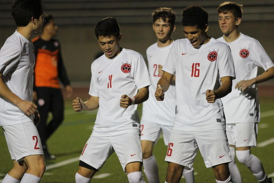 During Tuesday night's match against W.T. White, Coppell High School senior forward Nick Taylor (left) and junior forward Francisco Redondo (right) celebrate after scoring a goal. Coppell defeated W. T. White with a final score of 4-1 at Buddy Echols Field.
