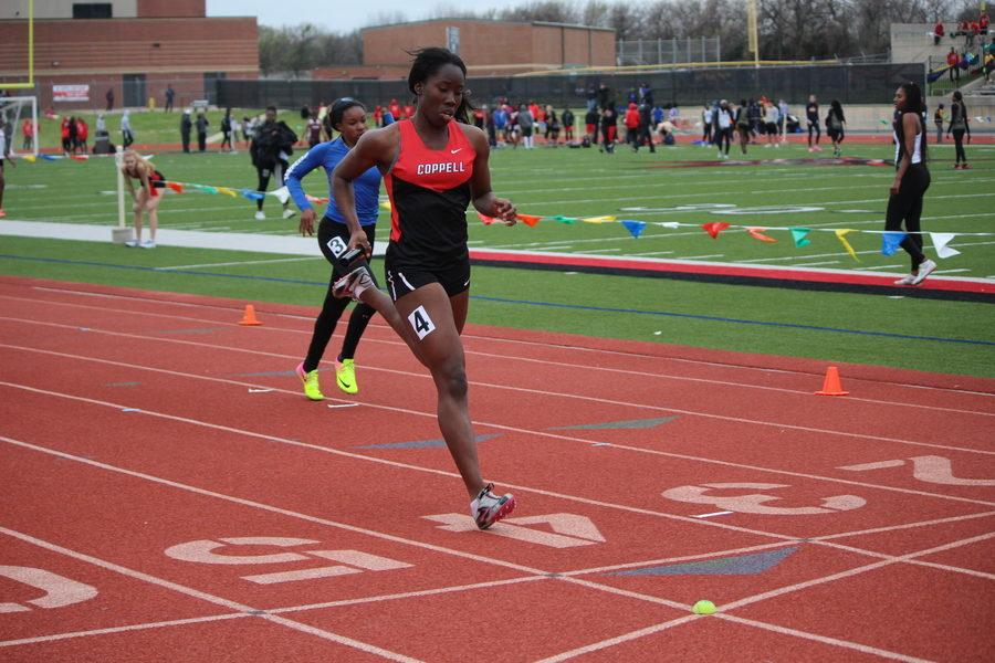 Coppell High School junior Rachel Okereke crosses the finish in second place during the second heat of the girls 4x200m Relay of the Coppell Relays held at Buddy Echols Field on Saturday. Coppell placed second overall in this competition with a time of 1:46.43.