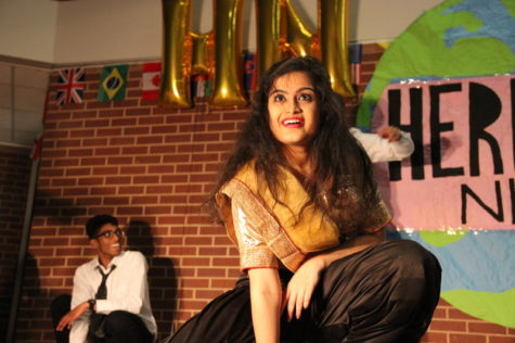 Coppell High School senior Kirtana Kalavagunta strikes a pose at Heritage Night on Friday night in the CHS commons. Heritage Night is where people of different heritages come together for one night and show off their talents and skills. Photo by Hannah Tucker.