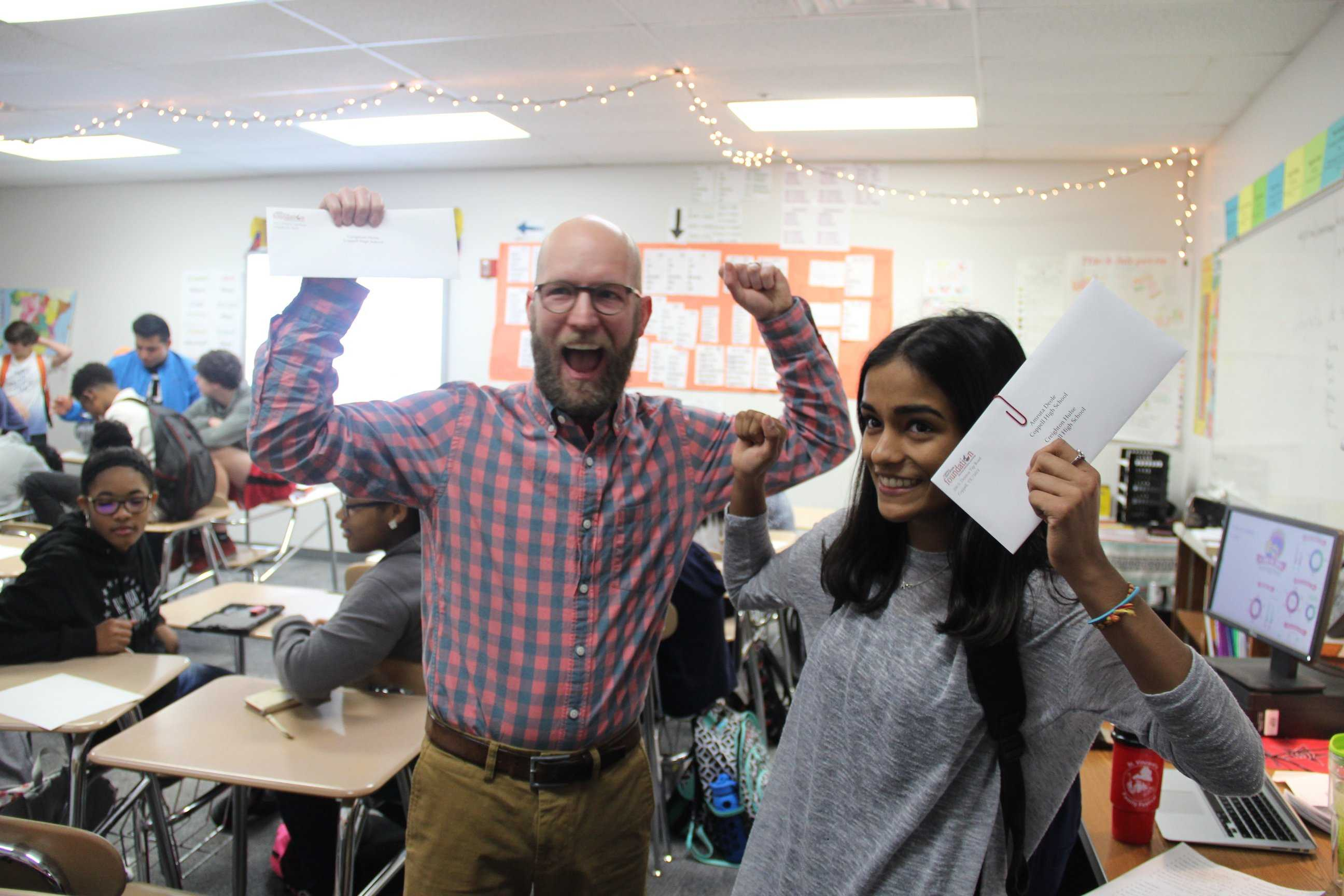 Coppell High School senior Amruta Deole surprises CHS IB Spanish teacher Creighton Hulse with an invitation to the Coppell Education Foundation Academic Recognition Banquet on Thursday. Seniors ranked in the top five percent were able to select one teacher who has impacted their learning to accompany them on April 25.