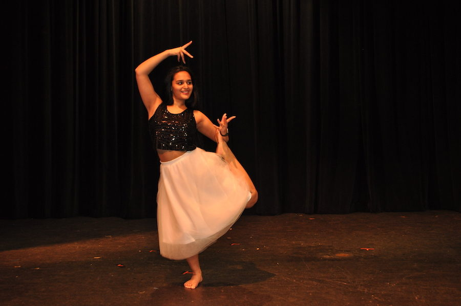 Coppell+High+School+senior+and+Dance+to+Make+a+Difference+club+president+Swetha+Venigandla+balances+in+an+Indian++dance+pose+at+the+show+the+club+hosted+Friday+night+in+the+CHS+auditorium.+The+club+raised+between+%24800+and+%24900+for+the+American+Foundation+for+Suicide+Prevention+through+this+event.+%0A